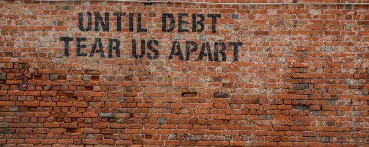 debt-tear-apart